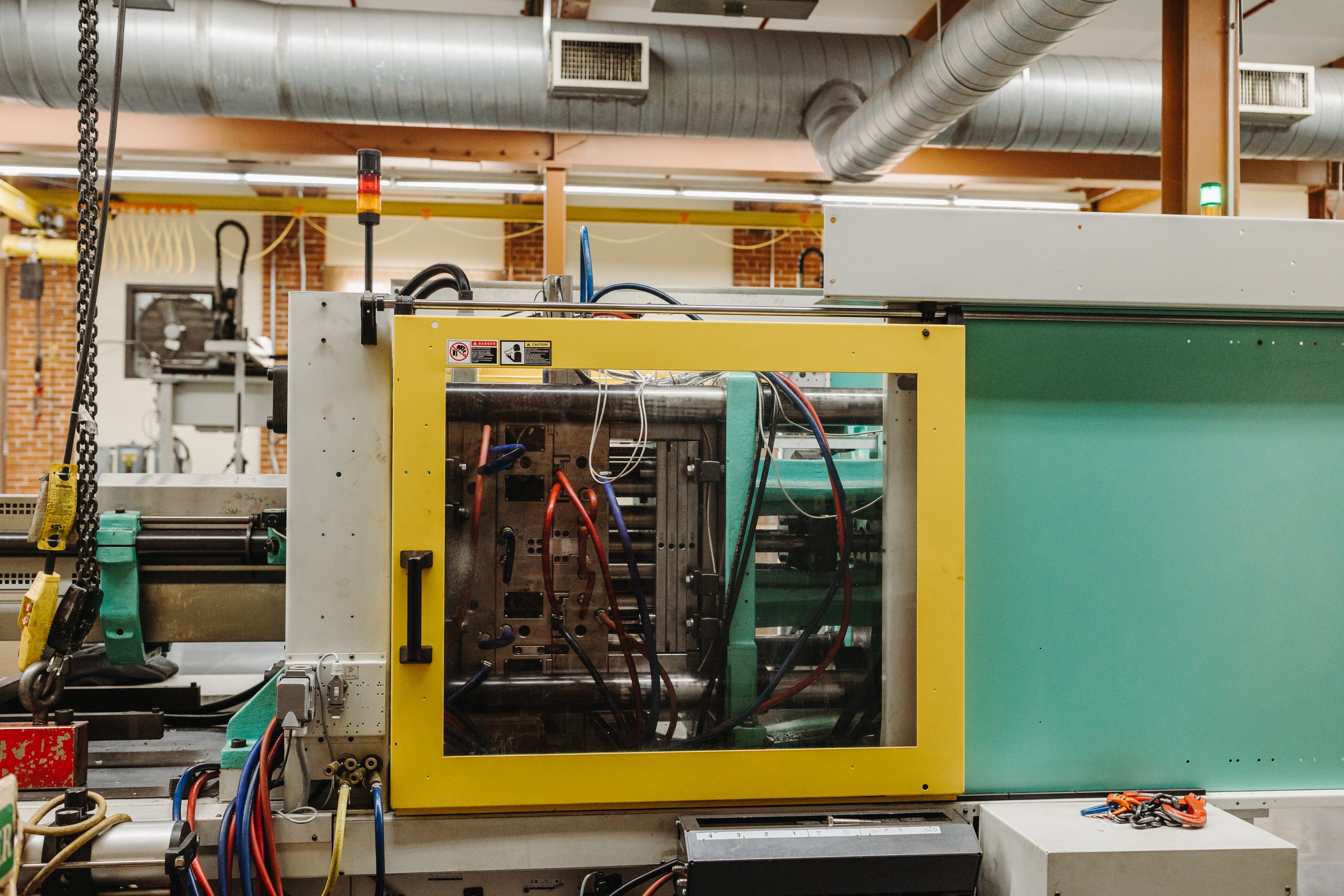 Close up of an injection molding machine that produces sensors