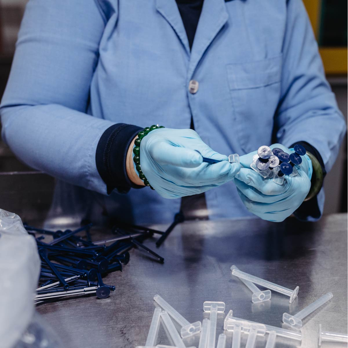 Close up of a woman who is assembling a medical device