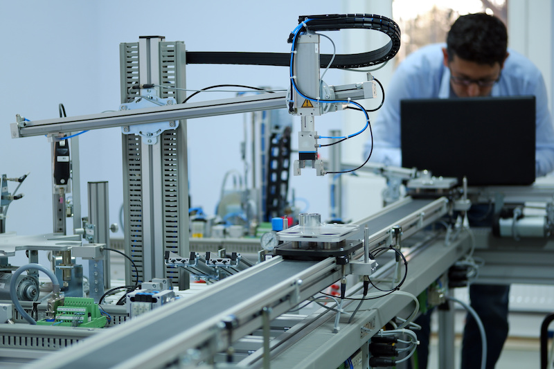 Close-up of an automated contact assembly machine