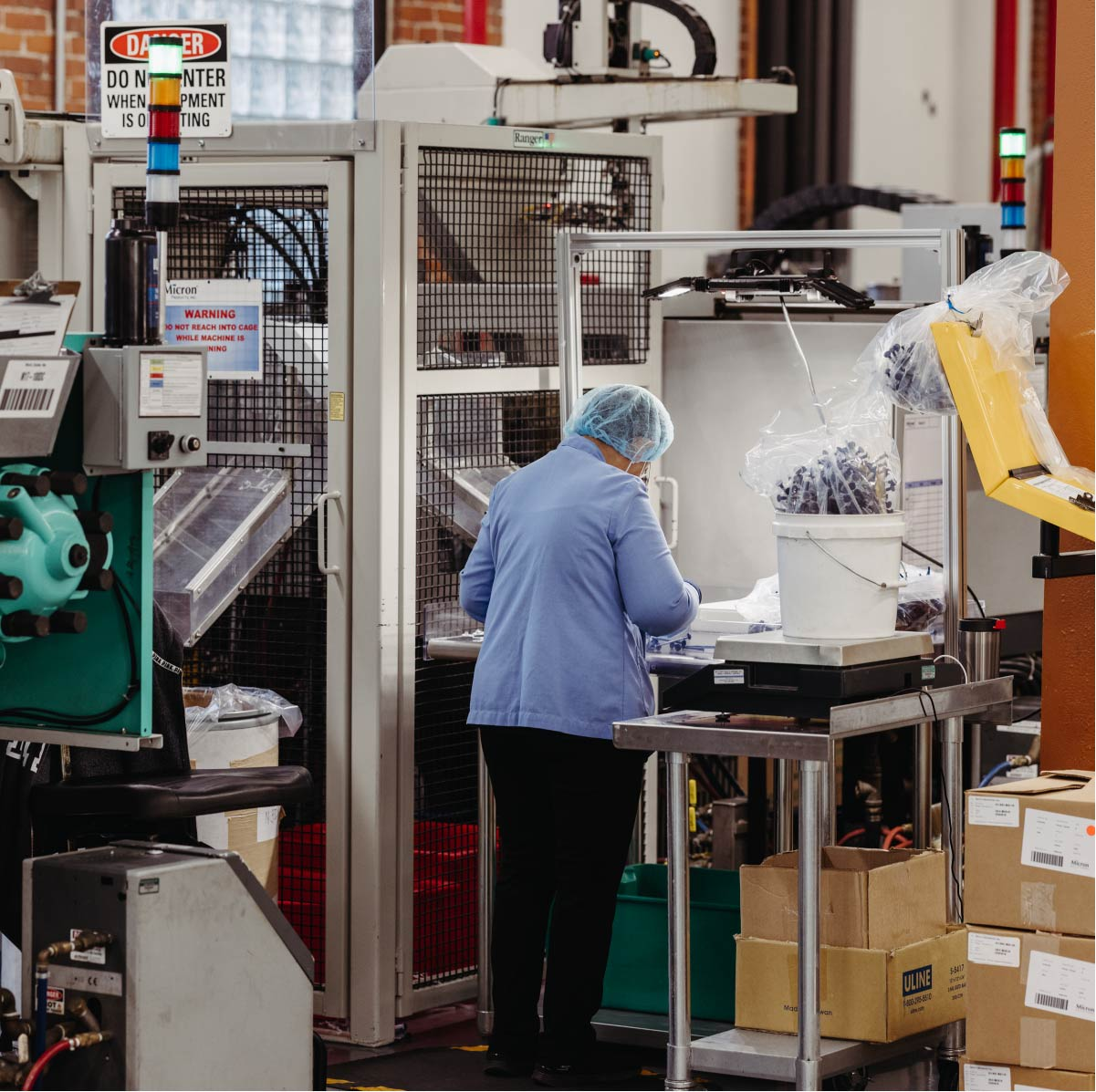 An employee works on assembling medical devices